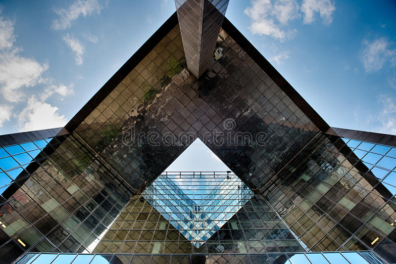 Office glass building in abstract. Office skyscraper towards a blue sky. Glass building in abstract stock photos