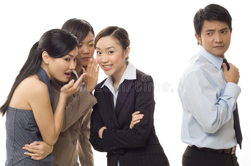 Office Gossip 2. Three attractive young female workers gossip about one of the male staff stock photo