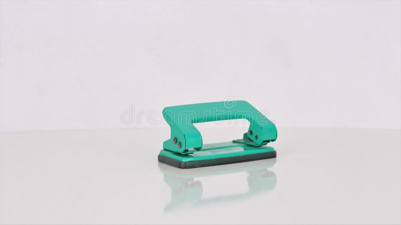 office hole punch in green stock images