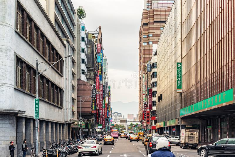 Office and hotel buildings in downtown of Taipei, Taiwan. Taipei, Taiwan - Jan 16, 2017: Office and hotel buildings along Zhongxiao West Road in downtown of stock photography