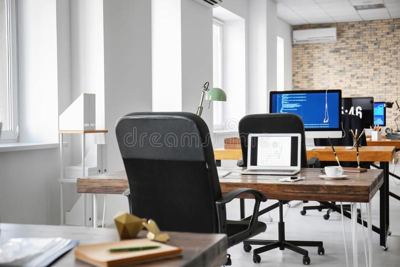 Office interior with computers and tables. Workplace design royalty free stock photography