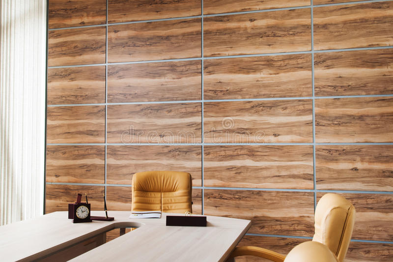 Office interior design with wall of synthetic wood panels royalty free stock image