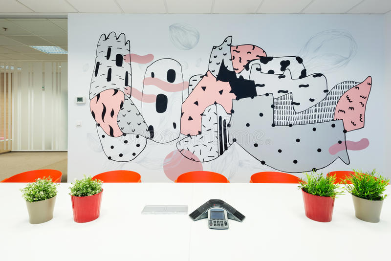 Office interiors created by Kivvi architects, Bratislava, Slovakia. BRATISLAVA, SLOVAKIA - FEB 18, 2016: Modern attractive design of office interiors in IT royalty free stock image