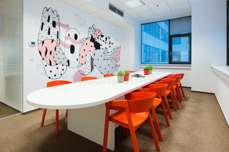 Office interiors created by Kivvi architects, Bratislava, Slovakia. BRATISLAVA, SLOVAKIA - FEB 18, 2016: Modern attractive design of office interiors in IT royalty free stock photography