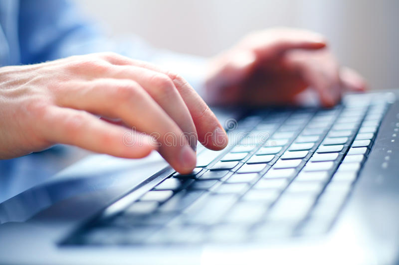 Office job. Image of man's hands typing. Selective focus