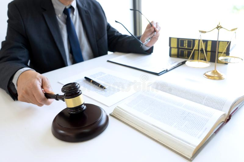 In the office of Judge or lawyer. There are balance and gavel on the table. Law firm Concept, legal, justice, judgment, library, court, attorney, hammer royalty free stock photography