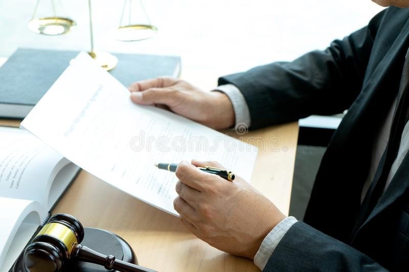 In the office of Judge or lawyer. There are balance and gavel on the table. Law firm Concept, legal, justice, judgment, library, court, attorney, hammer royalty free stock photo