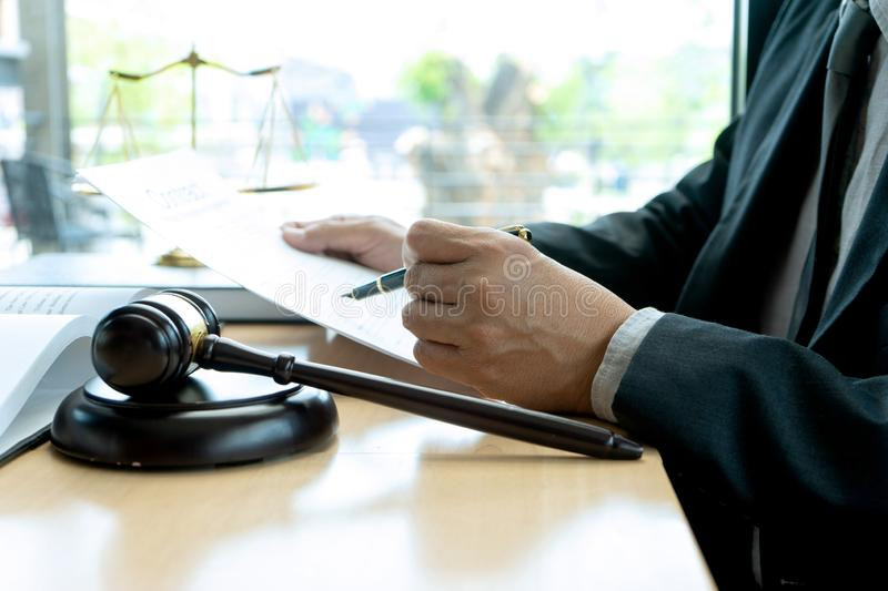 In the office of Judge or lawyer. There are balance and gavel on the table. Law firm Concept, legal, justice, judgment, library, court, attorney, hammer stock images