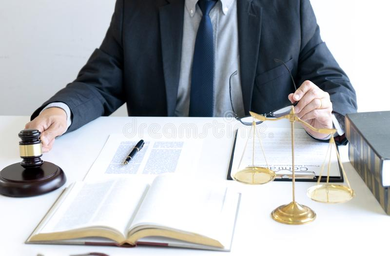 In the office of Judge or lawyer. There are balance and gavel on the table. Law firm Concept, legal, justice, judgment, library, court, attorney, hammer stock photo