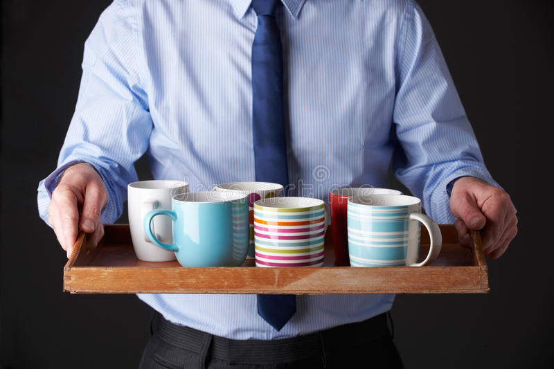 Office Junior Carrying Tray Of Cups royalty free stock photo
