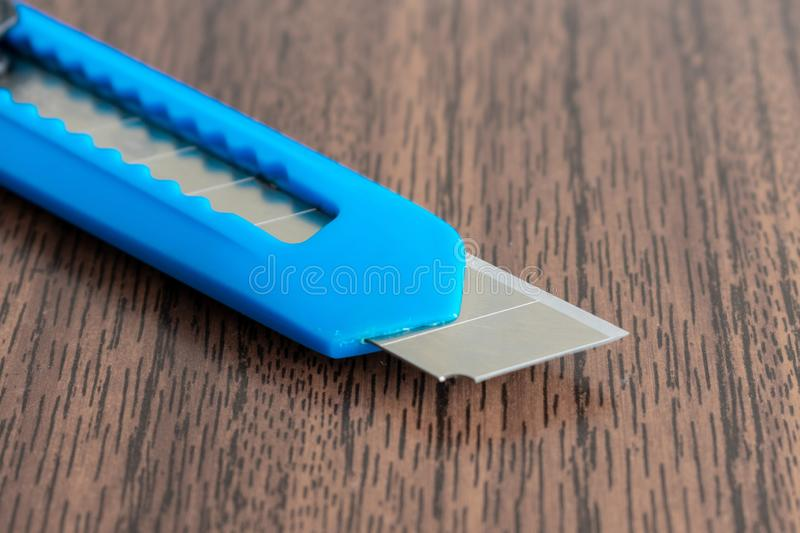Office knife on brown Desk. Shallow depth of field. the concept of depression and suicide royalty free stock images