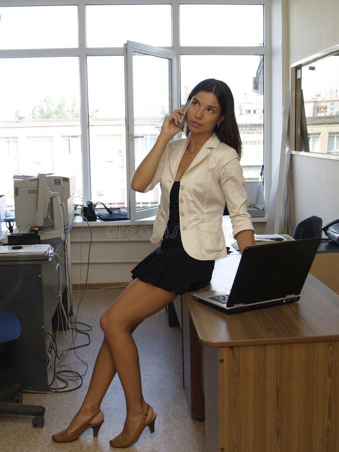 Office_lady_across_window immagine stock