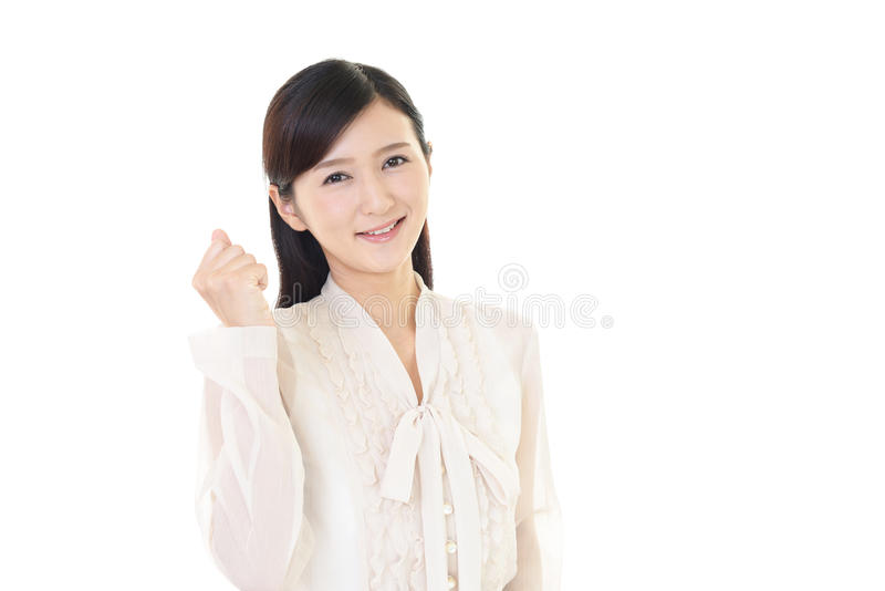 Office lady smiling. The woman who enjoys working isolated on white background royalty free stock image