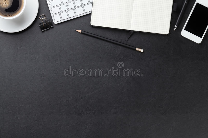 Office leather desk with computer, supplies and coffee. Office leather desk table with computer, supplies and coffee cup. Top view with copy space stock image