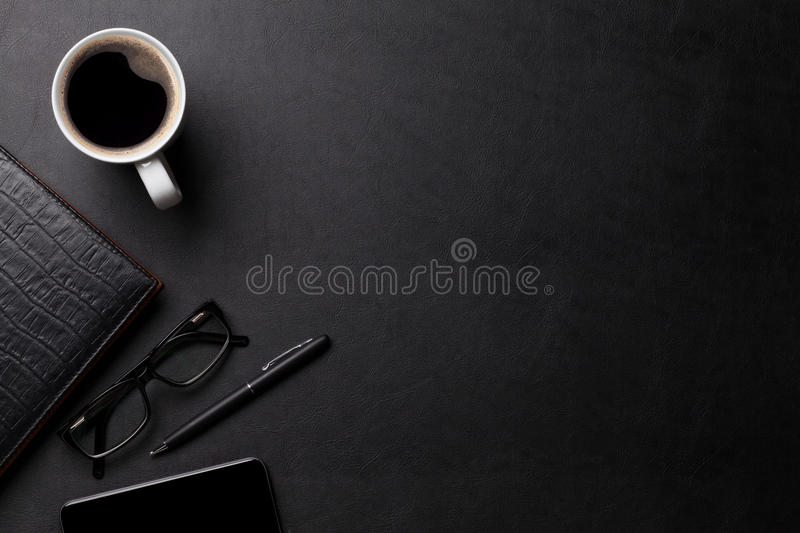 Office leather desk table with coffee and supplies stock photos