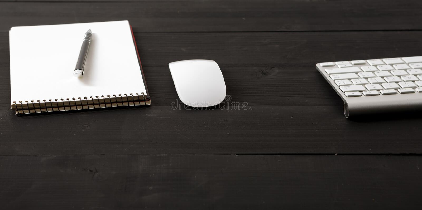 Office leather desk table with computer, supplies and coffee cup royalty free stock photo