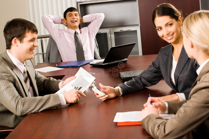 Office life. Several business people sitting at the table stock photos