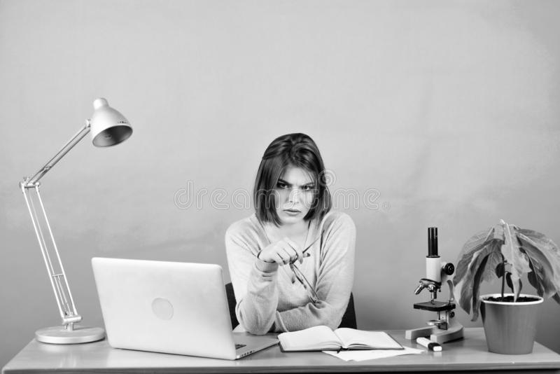 Office life. tired secretary at workplace. chemist biologist with microscope on table. digital science. businesswoman royalty free stock image