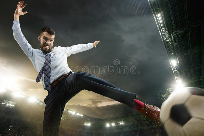 Office man as a soccer or football player at the stadium royalty free stock images