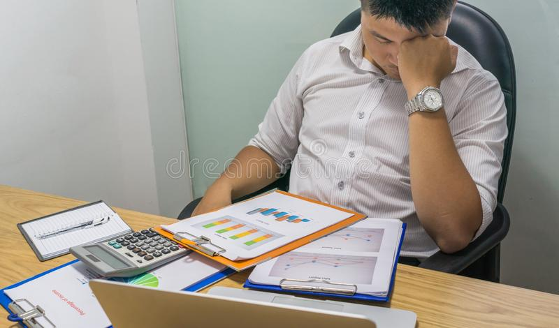 Office man feels tired and exhausted with his job royalty free stock photography