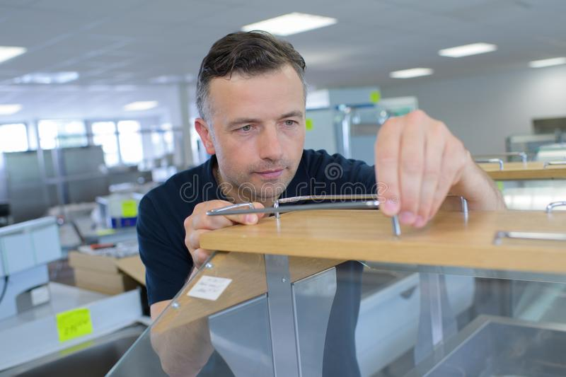 Office man tidying up office stock image