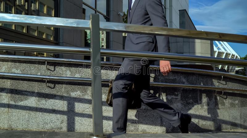 Office manager entering office building, going to working place, workaholic. Stock photo royalty free stock photo