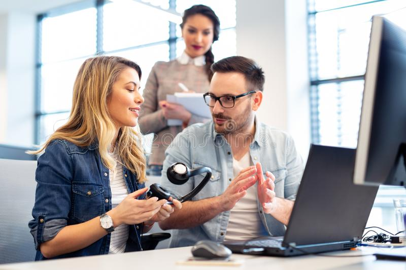 Office manager explaining to new employee what her job is at cal royalty free stock photography