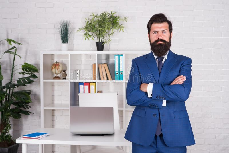 Office manager in formal fuit. serious and mature boss at workplace. everything in order and fits perfect. business life stock photos