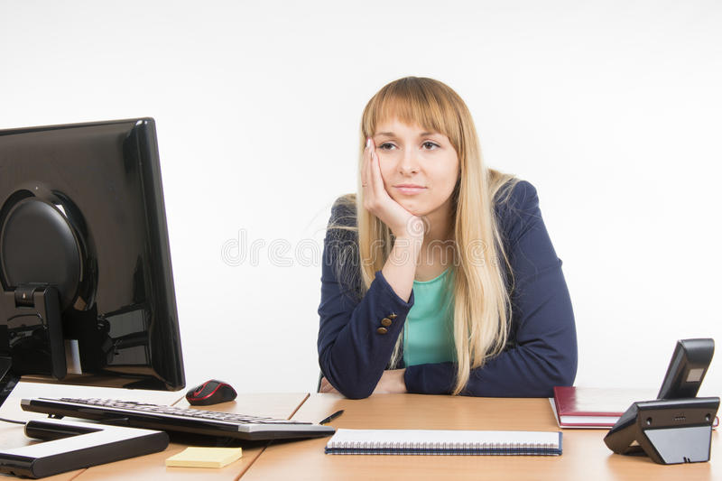 Office misses a specialist in the workplace. Young woman secretary sitting at office desk working, isolated on white background royalty free stock image