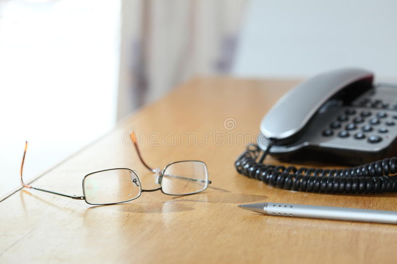 Office objects. Some work objects on a wooden table stock photo