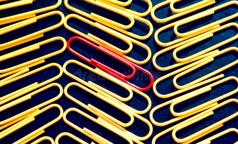 Office paper clips. Red yellow blue background symmetry line the same stock images