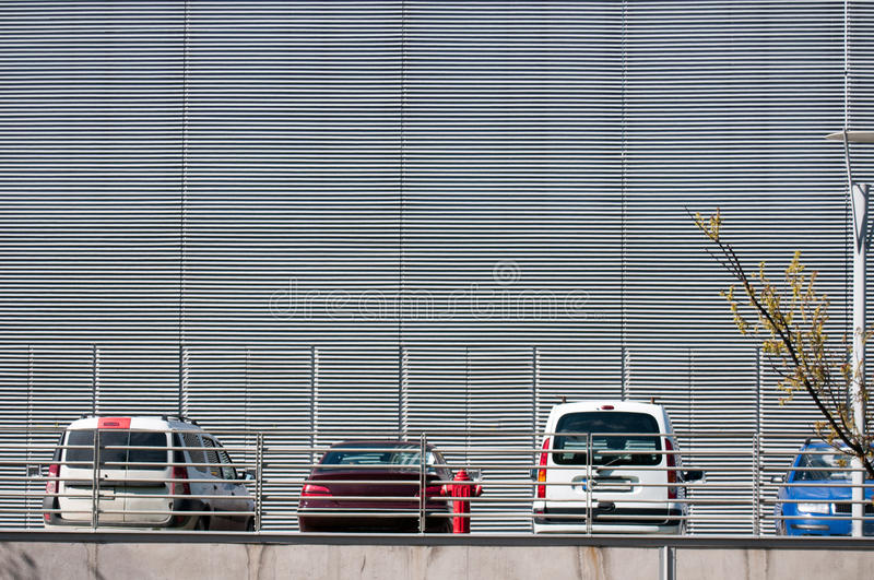 Office parking lot. Parked cars next to a modern building royalty free stock image
