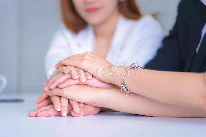 People putting hand together for business team success concept royalty free stock image