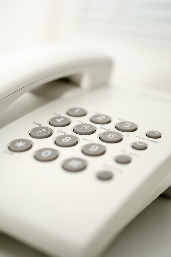 Office phone. Vertical image of office phone royalty free stock photography