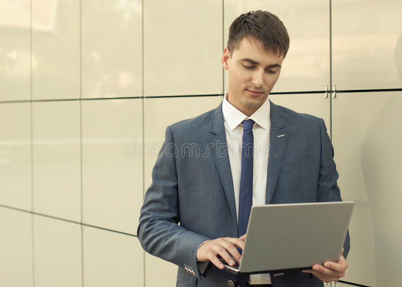 Office portrait of smiling young businessman stock photos
