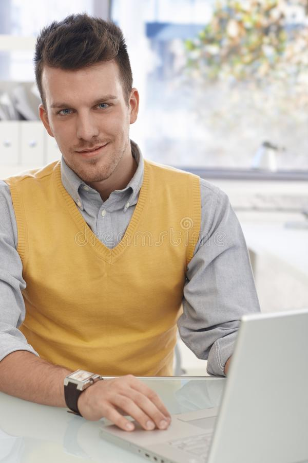Office portrait of young businessman smiling royalty free stock photography