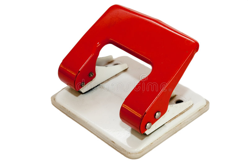 Office puncher. Old metal office paper puncher on white royalty free stock image