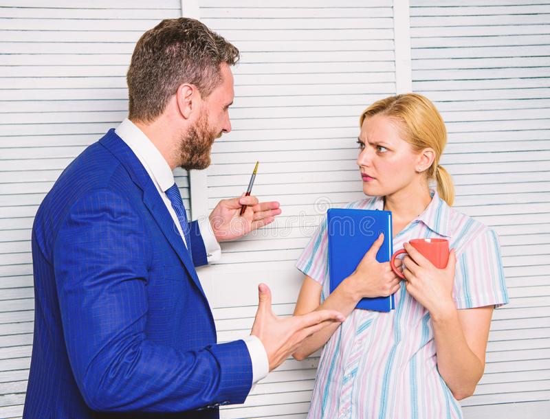 Office quarrel concept. Misunderstanding between colleagues. Prejudice and personal attitude to employee. Tense. Conversation or quarrel between colleagues royalty free stock photos
