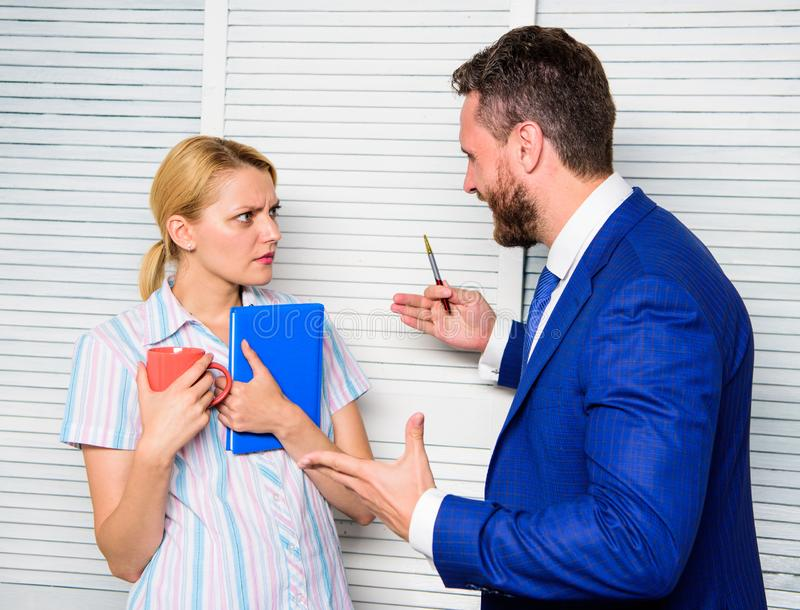 Office quarrel concept. Misunderstanding between colleagues. Prejudice and personal attitude to employee. Tense. Conversation or quarrel between colleagues royalty free stock photo