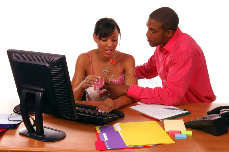 Office Romance. African American executive brings a flower to his secretary. Perhaps a budding office romance or maybe a show of gratitude on Secretary's Day stock image
