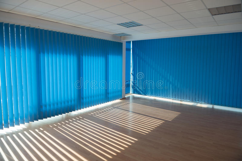 Office room. Empty office room with blue blinds stock photos
