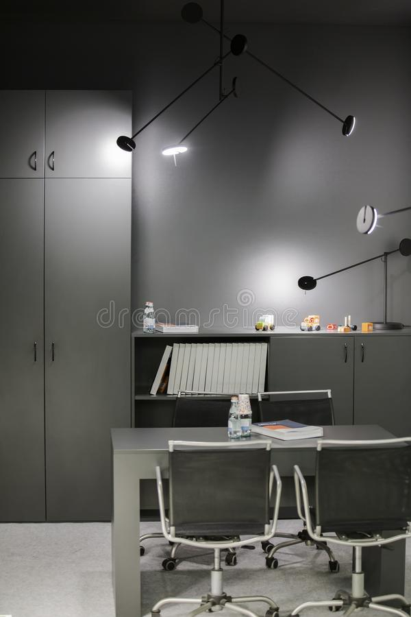 Office room for children in gray color. Interior design furniture.  stock photos