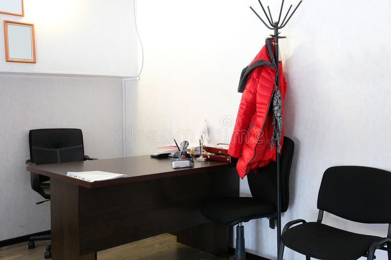 Office room. Interior of an office room with chair, table and stationery on it stock images