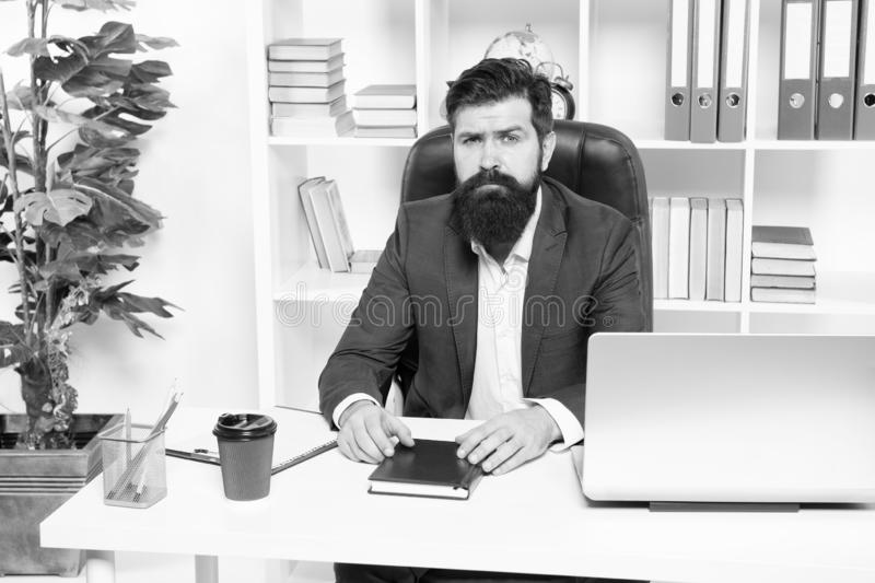 Office routine. Businessman in charge of business solutions. Developing business strategy. Risky business. Man bearded. Hipster boss sit office with laptop stock image