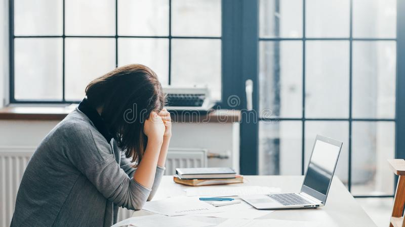 Office routine overloaded tasks deadlines. Office routine. Business lifestyle. Stressed out female worker overloaded with difficult tasks, caring about deadlines stock photos