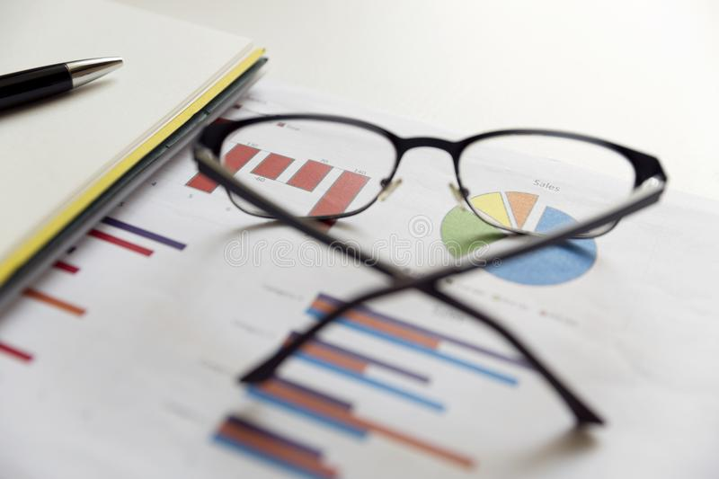 Office scene: financial graphs and charts. Financial data concept stock images