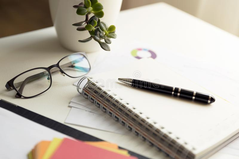Office scene: financial graphs and charts. Financial data concept stock photography