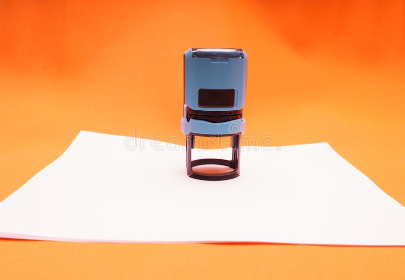 Office seal, stamp on blank white sheet of paper, close-up stock illustration