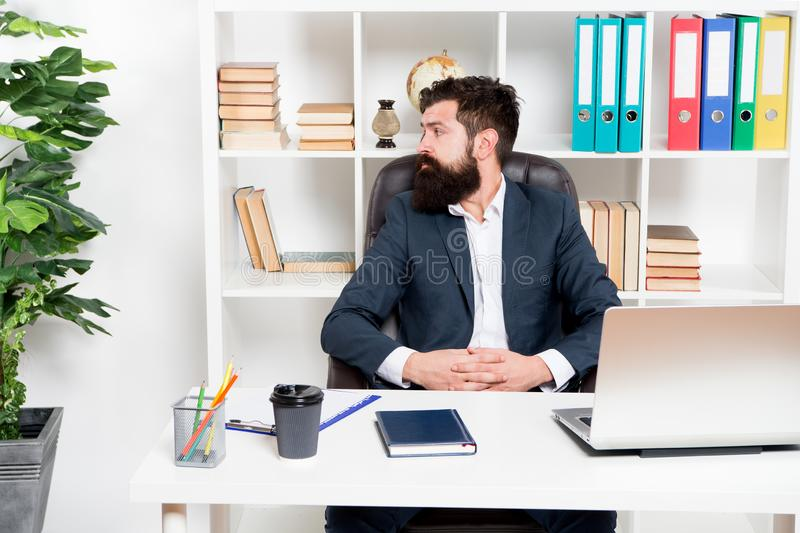 Office staff concept. Businessman in charge of business solutions. Developing business strategy. Risky business. Man. Bearded boss sit with laptop. Manager royalty free stock images
