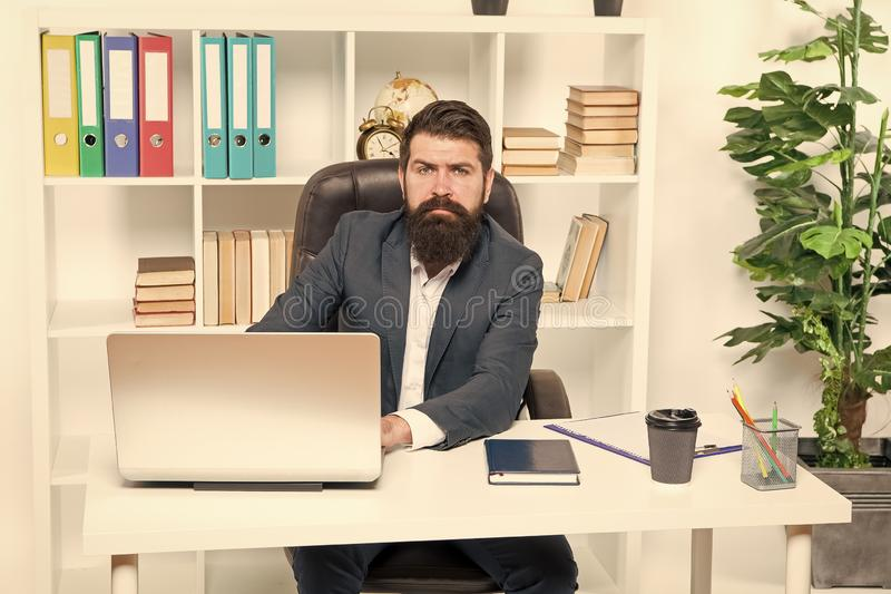 Office staff concept. Office routine. Businessman in charge of business solutions. Developing business strategy. Risky. Business. Man bearded boss sit with stock image